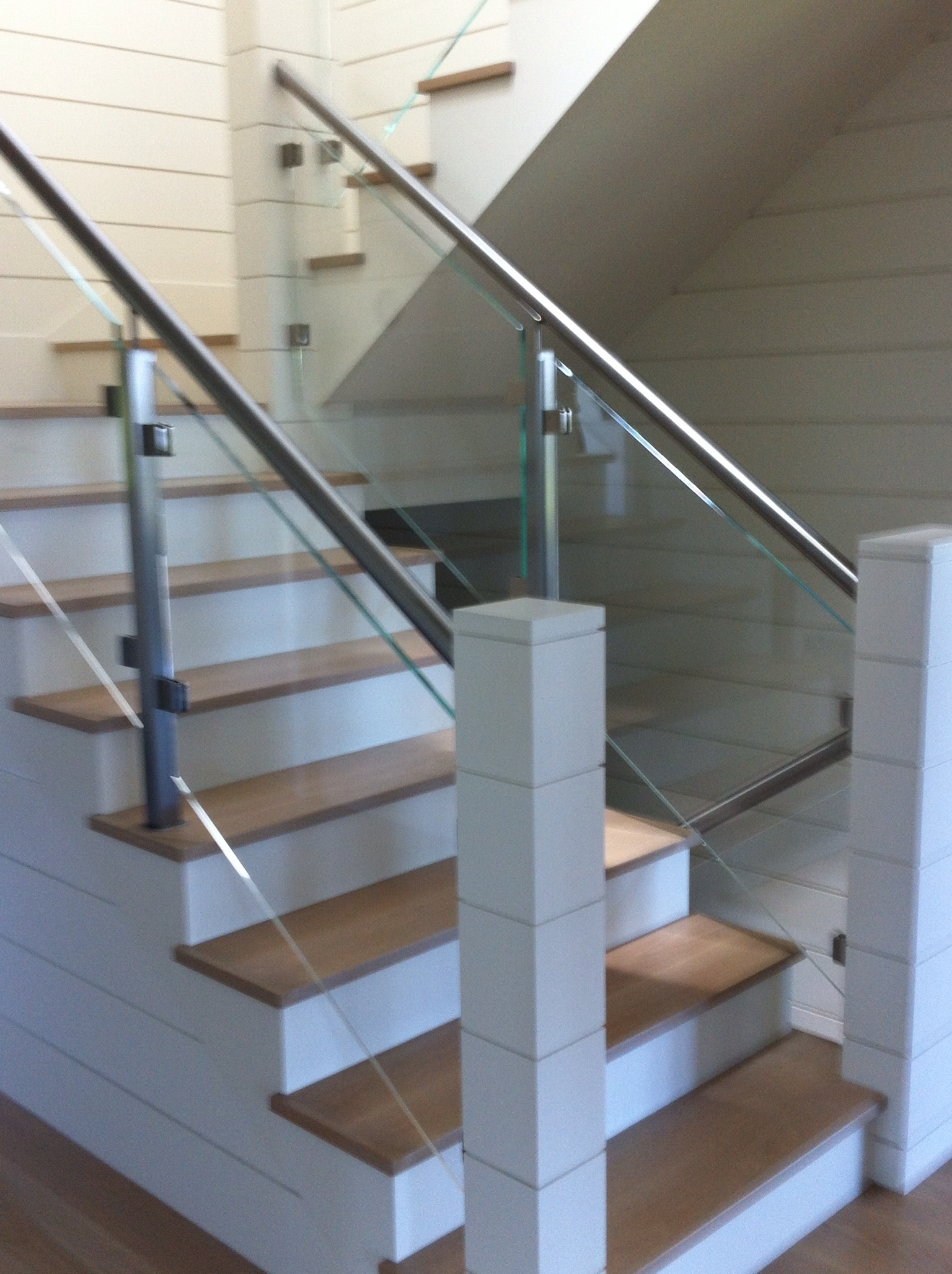 Glass, wood and chrome staircase.