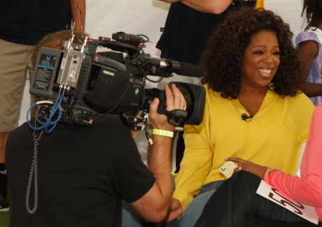 Oprah smiling for the cameras.