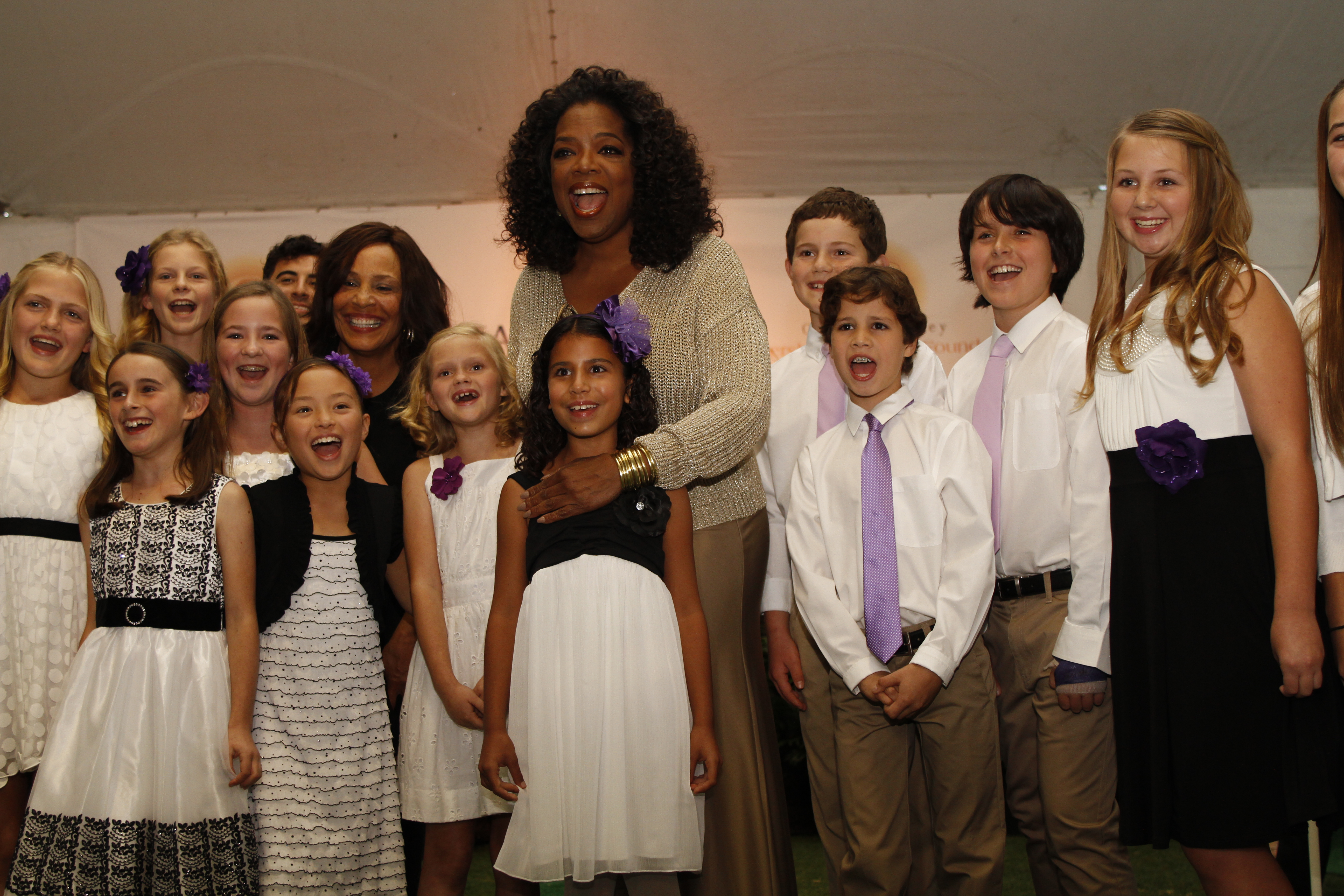 Oprah with The Janice Adderley School for the Performing Arts Singers.