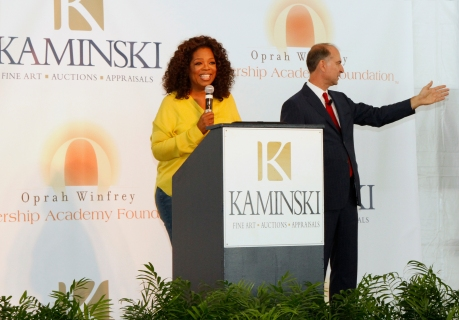 Oprah kicking off the bidding on the first few lots.