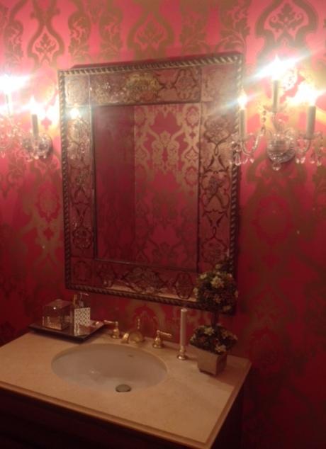 My over the top Designers Guild wallpaper with my new Venetian mirror auction purchase.