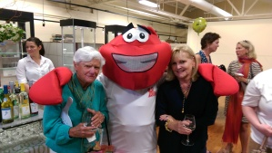 Tennis Hall of Fame great Avis Murray and Mrs. Bonnie Covington with the Boston Lobster mascot